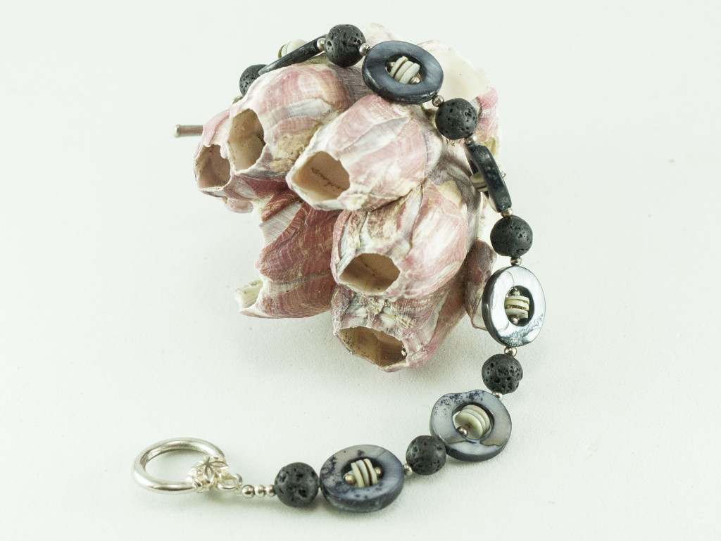 Handcrafted with natural shell and lava stone beads.